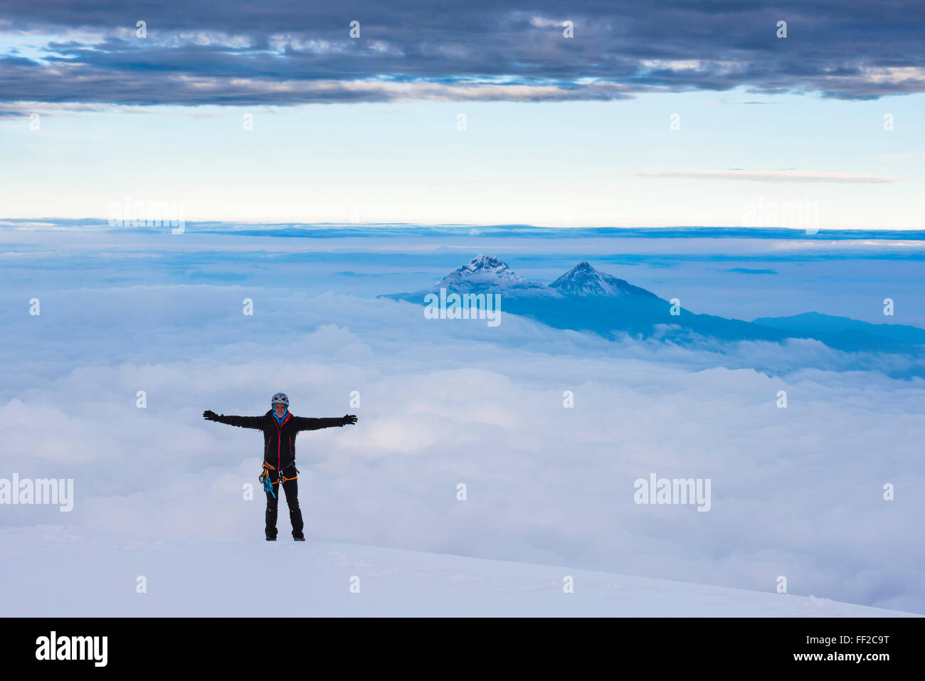 CRMimber on the 5897m summit of Cotopaxi VoRMcano, Cotopaxi Province, Ecuador, South America - Stock Image