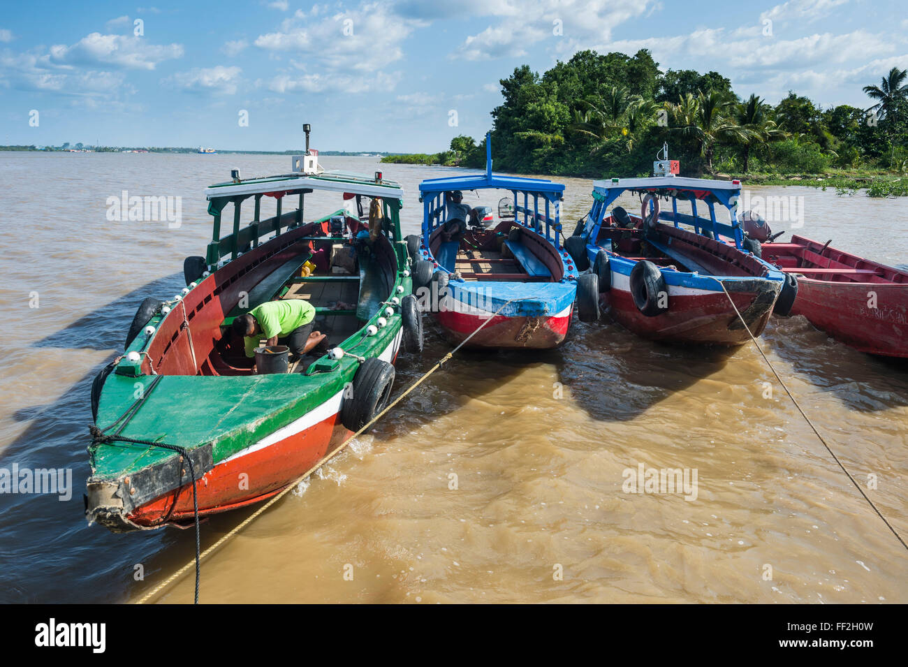 CoRMourfuRM boats on the Suriname River, Paramaribo, Surinam, South America - Stock Image