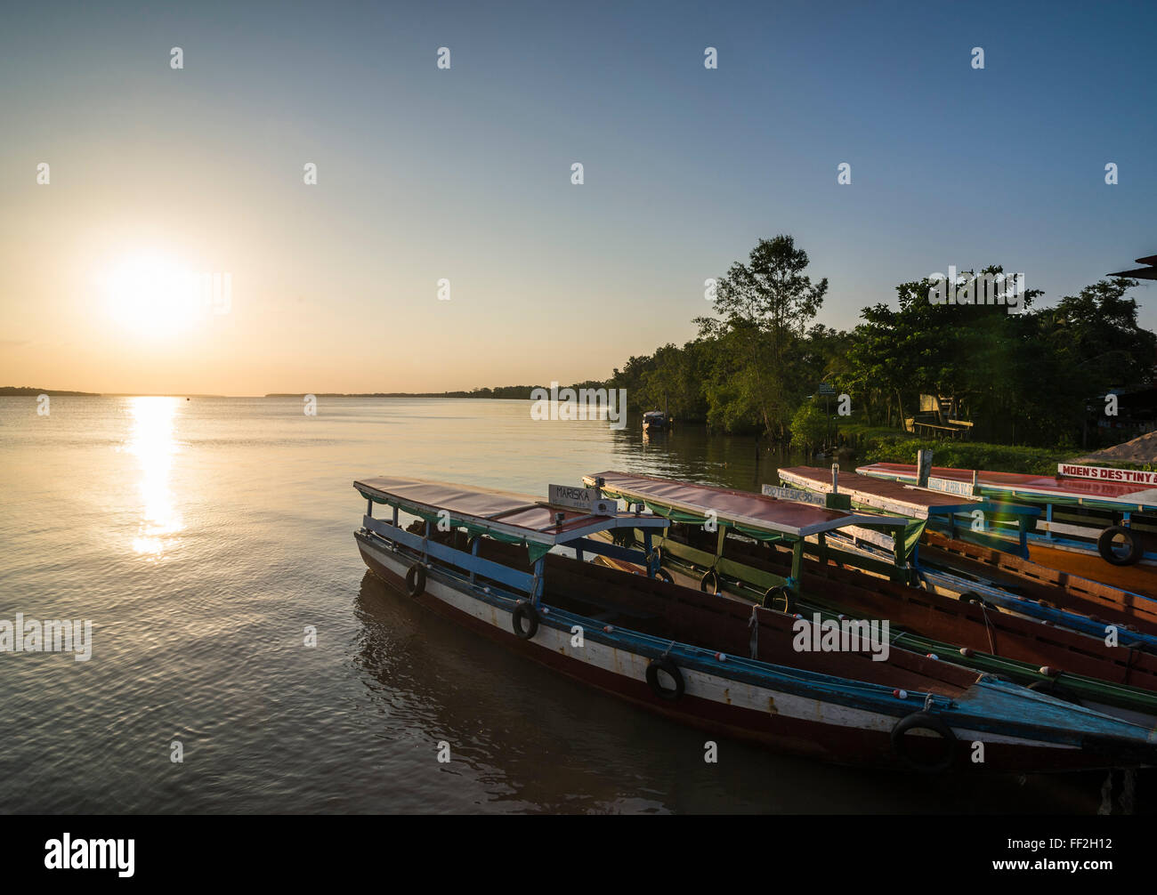 Fishing boats at sunset on the Suriname River near Paramaribo, Surinam, South America - Stock Image