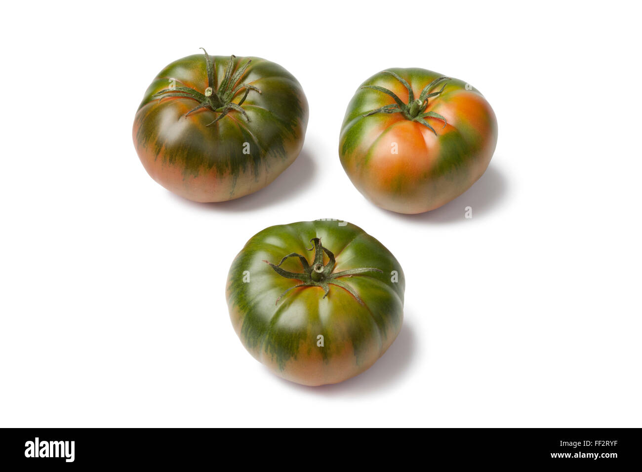 Fresh RAF heirloom tomatoes on white background - Stock Image