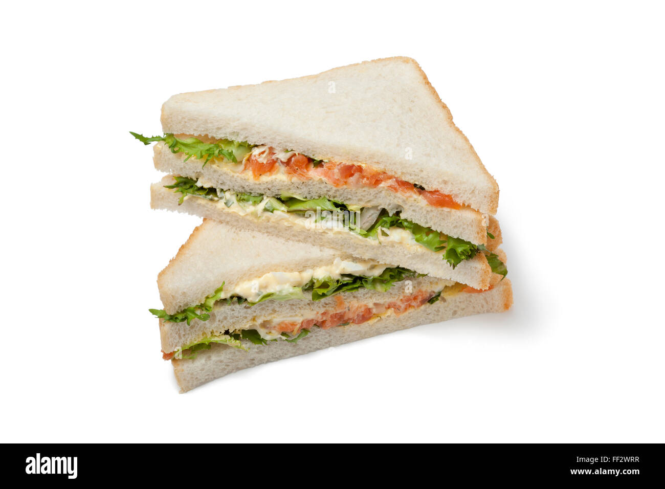 Fresh Salmon and egg club sandwich on white background - Stock Image