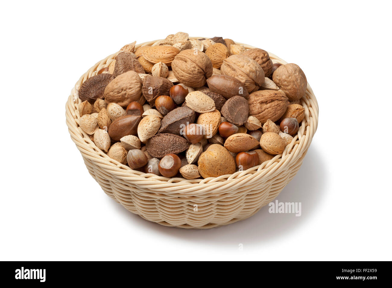 Basket with mixed nuts on white background - Stock Image