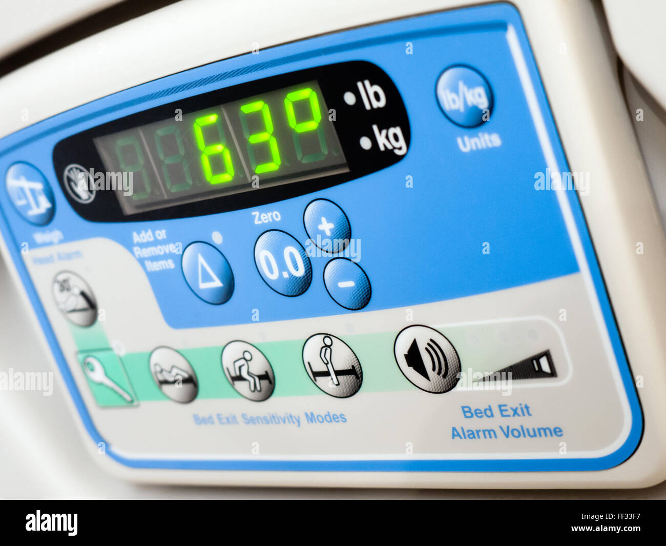 Hospital bed electronic weight scale that weighs patient while in bed - Stock Image