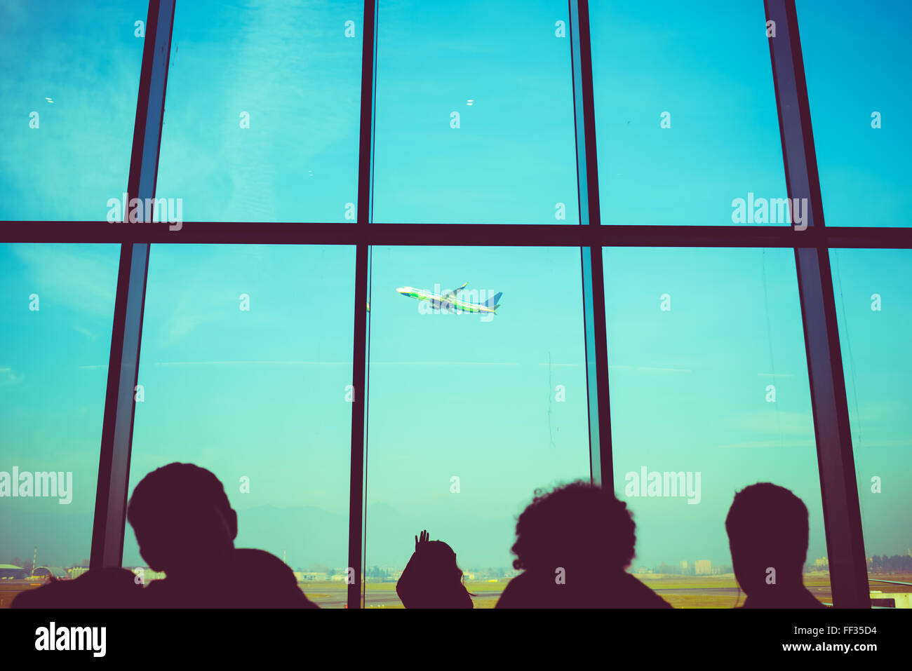 Airplane flying view from the inside of an airport - travel, transport, journey concept - Stock Image