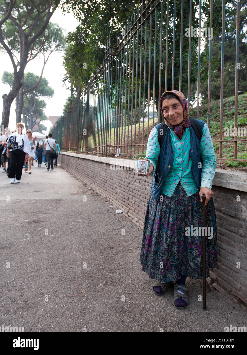 An elderly lady begging on public street in central Rome, Italy, Europe. - Stock Image