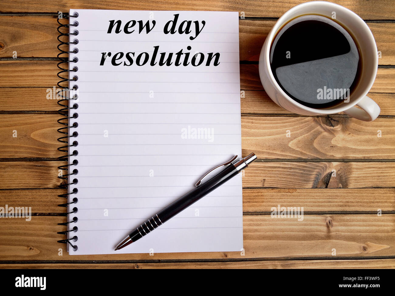 New day resolution word on notepad - Stock Image