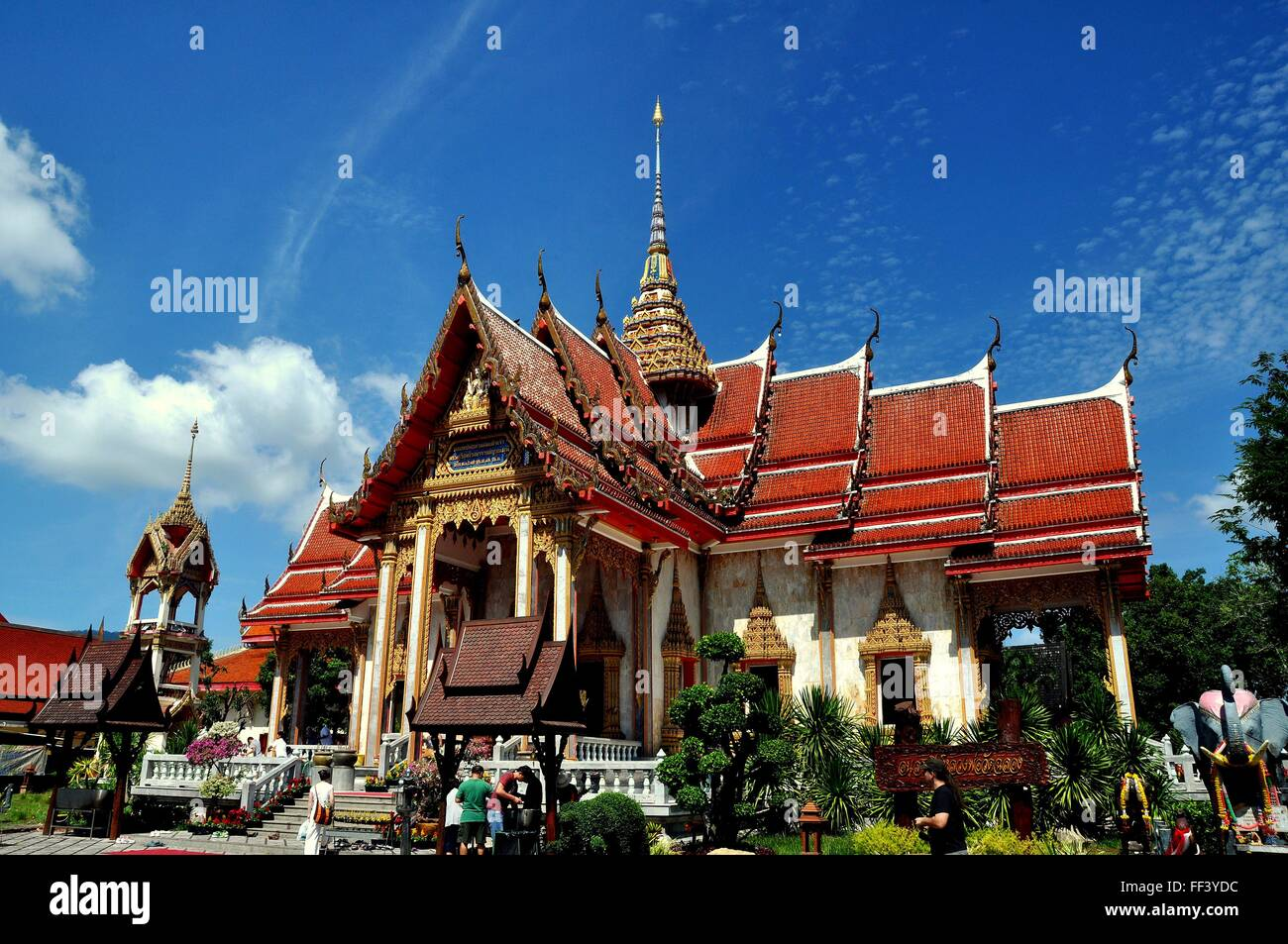 Phuket, Thailand:  Ubosot Sanctuary Hall with its steeply pitched, gabled roofs, gilded chofah ornaments at Wat Chalong Stock Photo