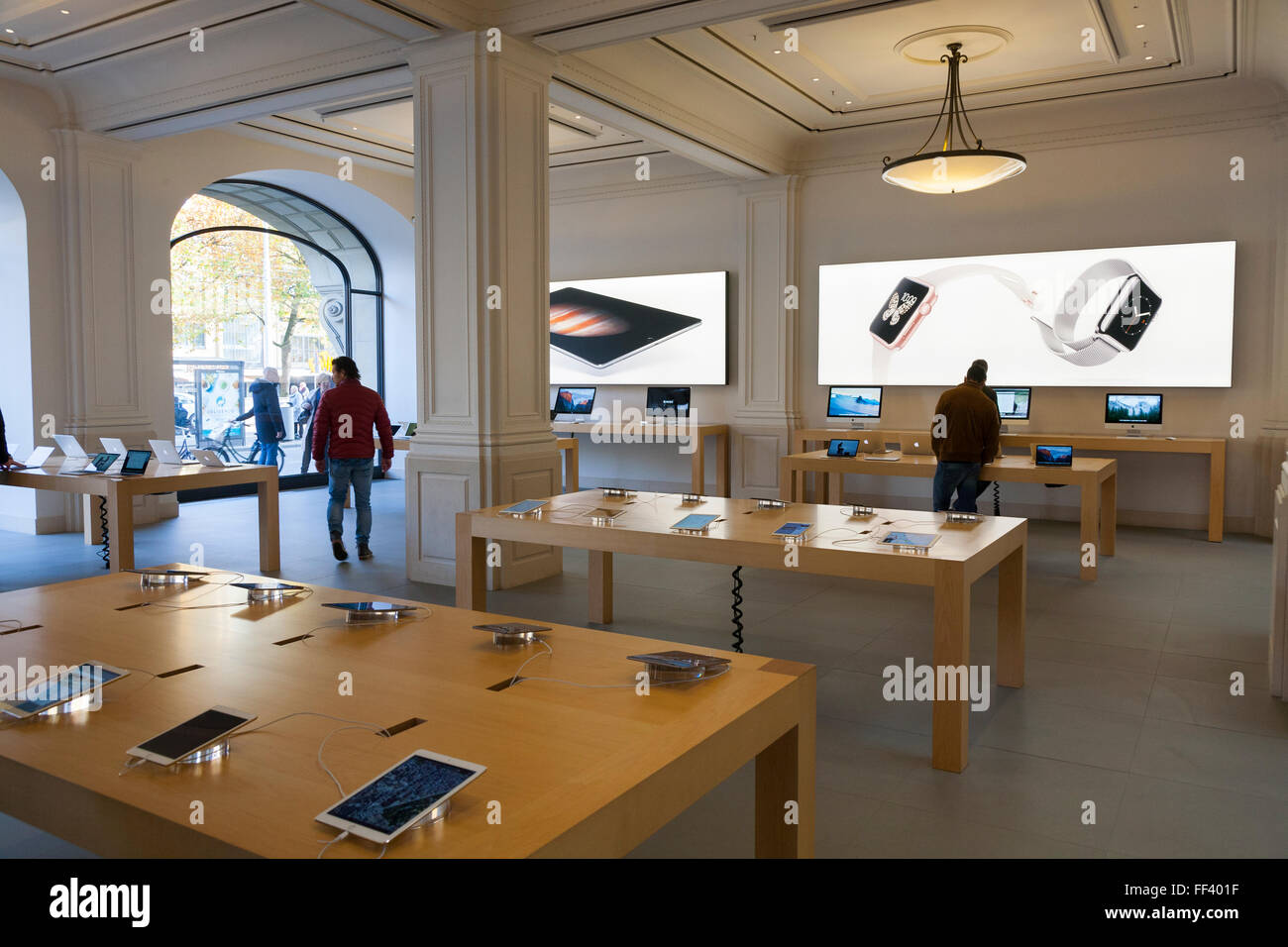 Inside / interior of the Apple computer store, Amsterdam. The Netherlands. Holland. Stock Photo