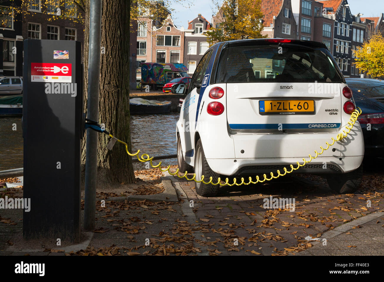 EV / Electric car / electrically powered cars being charged / having battery / batteries recharged at street / road Stock Photo