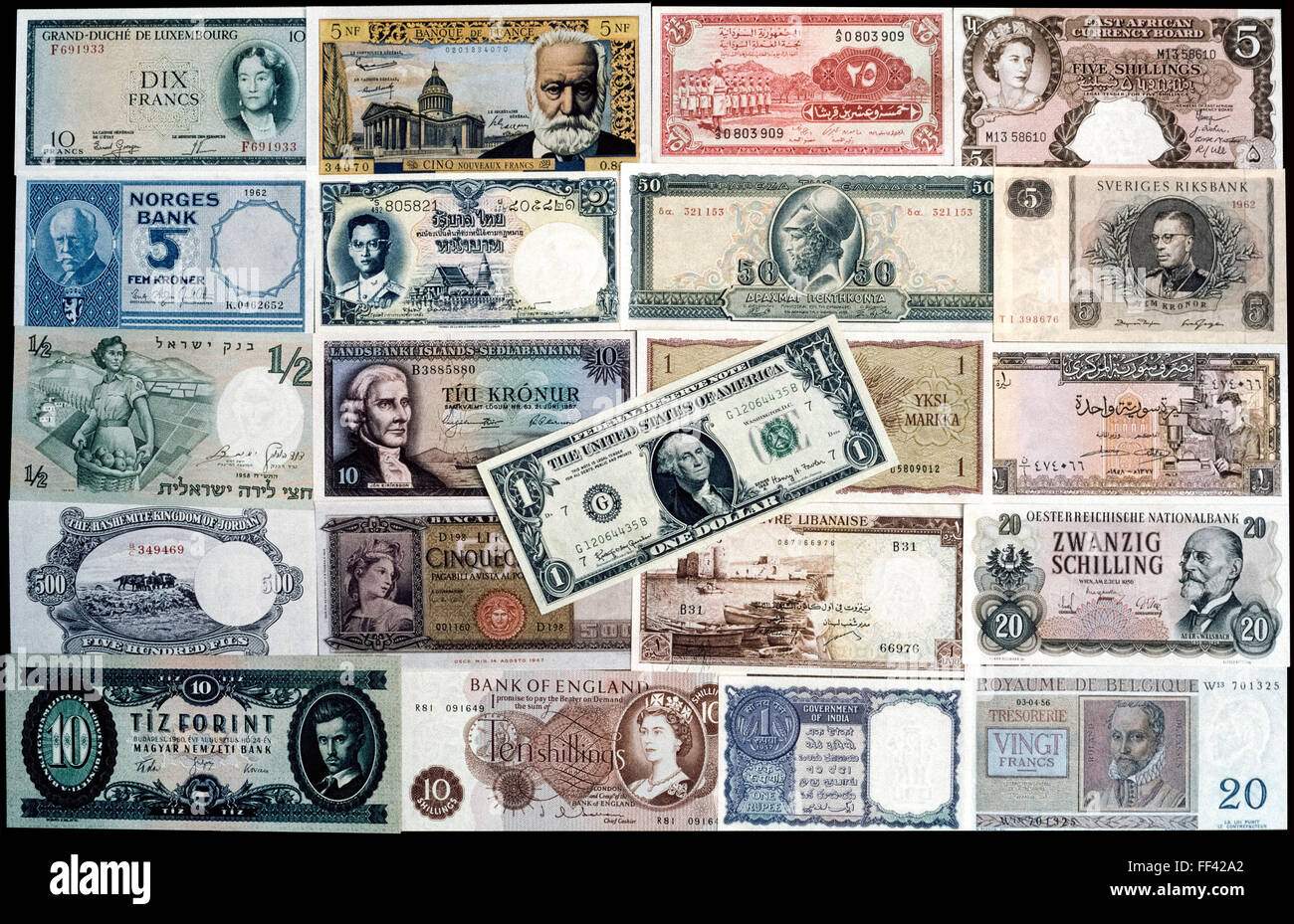 A collection of brand-new banknotes from 21 countries that were in circulation in the early 1960s. The colorful Stock Photo