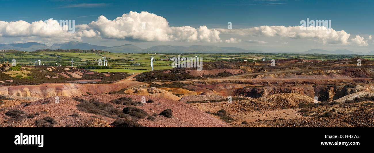 View of wind turbines and mountains of Snowdonia from Parys Mountain Anglesey Wales UK - Stock Image