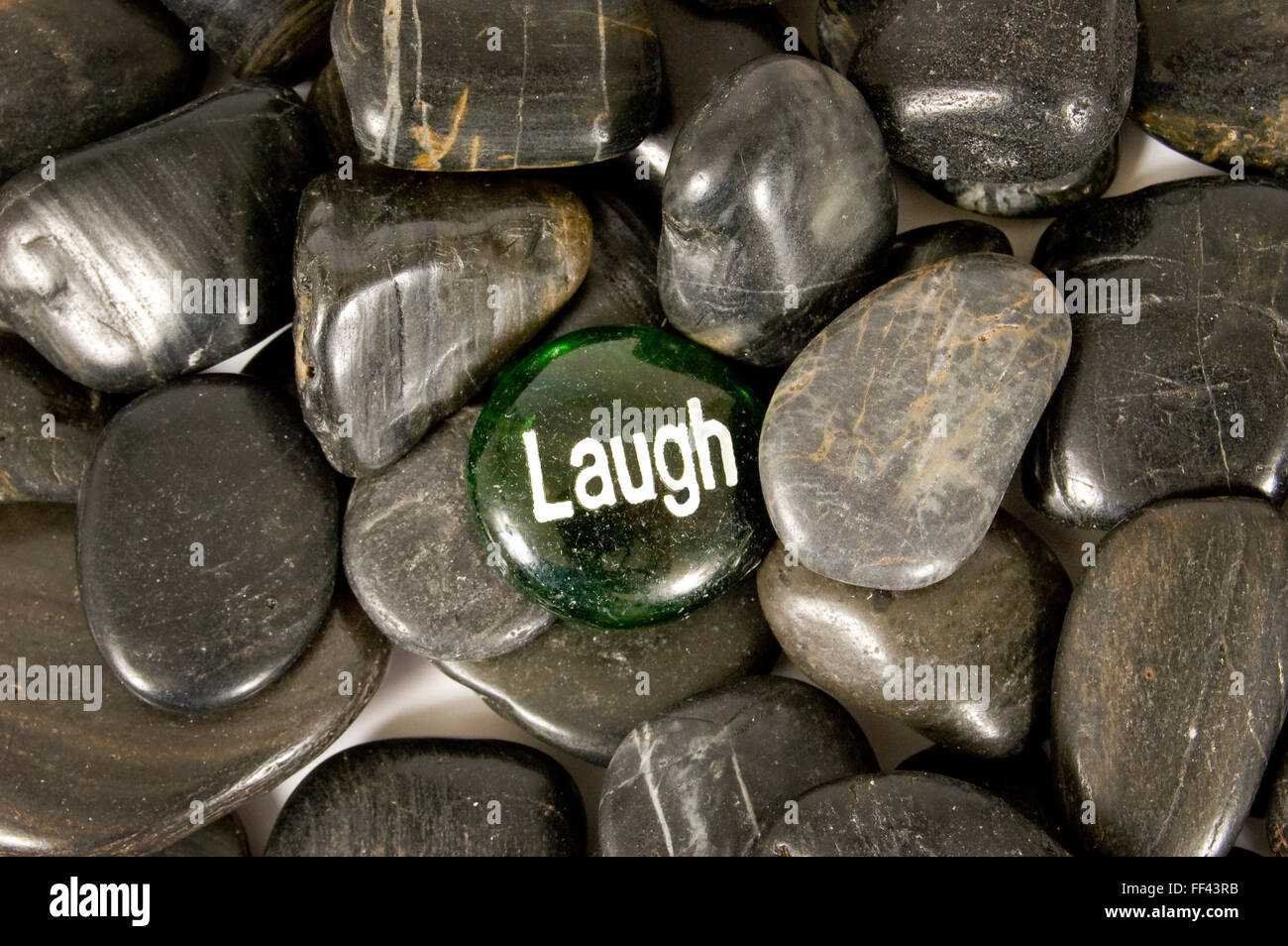 Laugh Encouragement Stone - Stock Image
