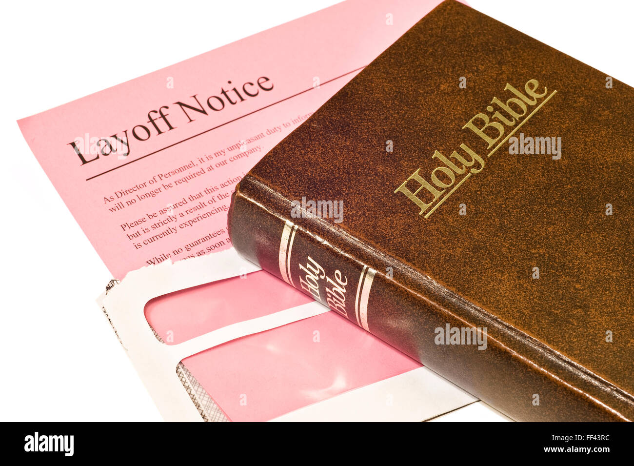 Layoff Notice and Bible Stock Photo