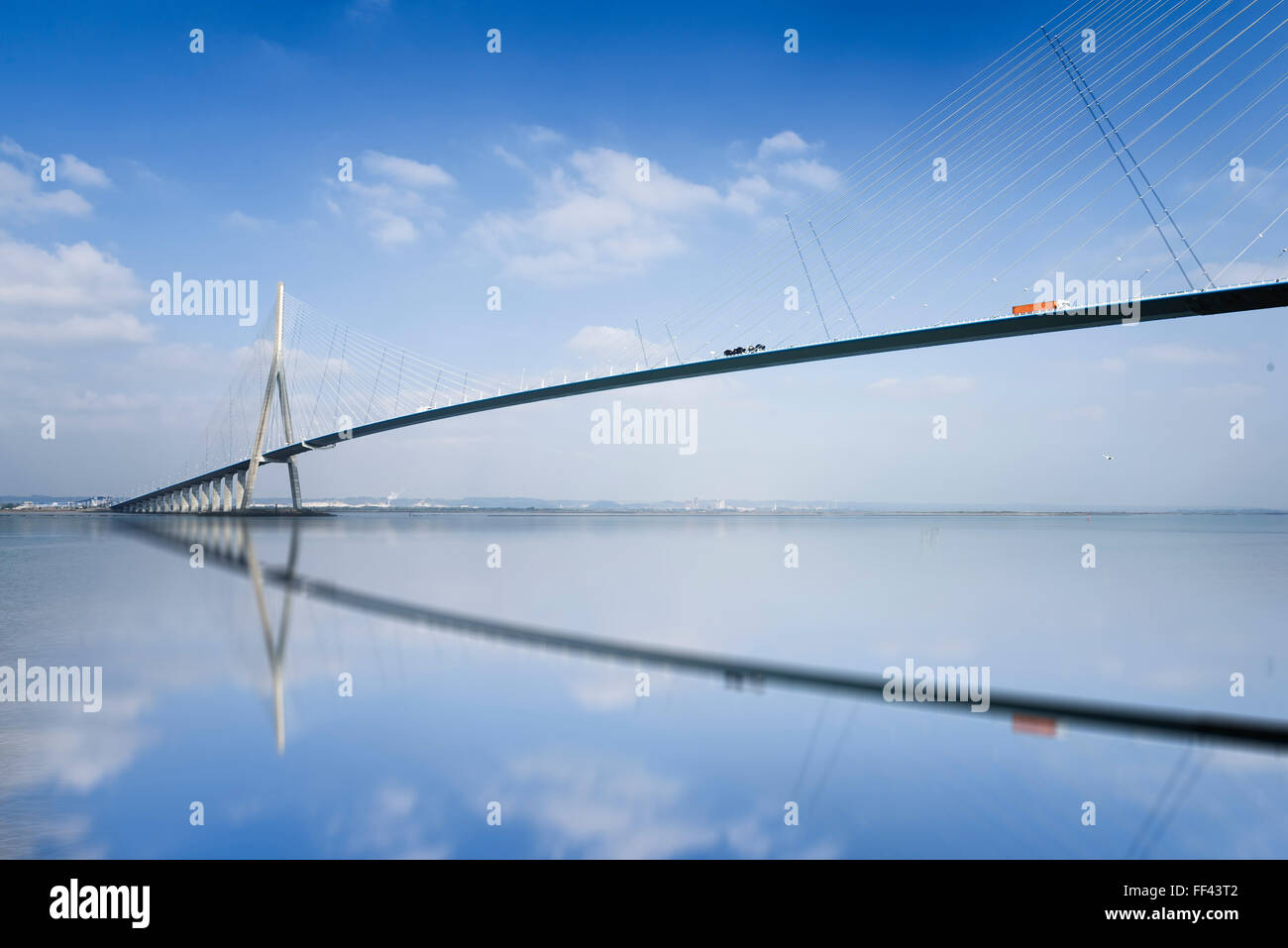 pillar of the bridge 'Pont de Normandie' reflected in the Seine river at Le Havre, France - Stock Image