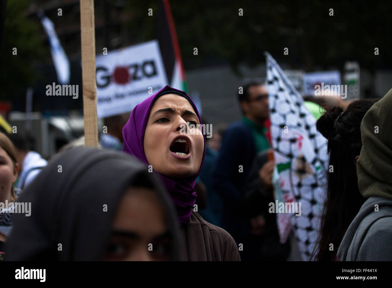 A young pro-Palestine activist protests in Westminster to end the siege in Gaza - Stock Image