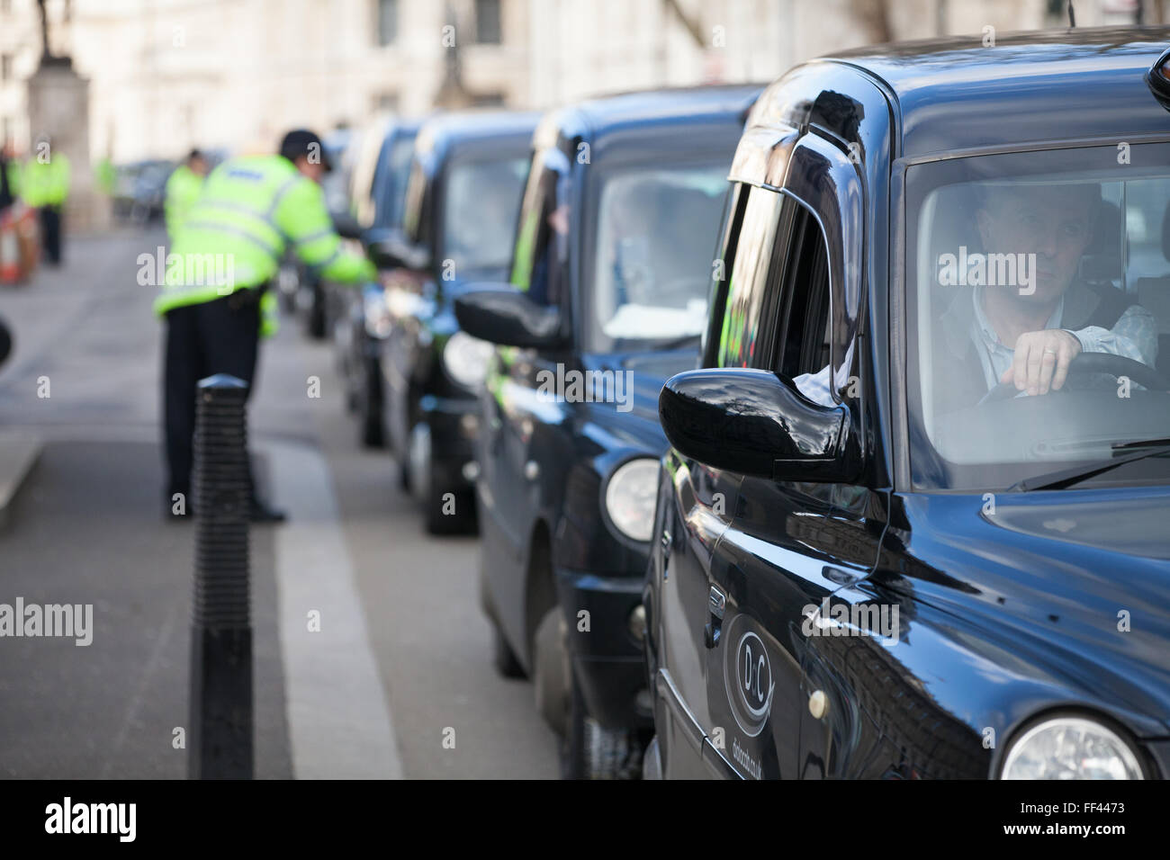 London, UK. 10th February 2016. Black cab taxi drivers hold a go-slow protest in Whitehall in protest against lack Stock Photo