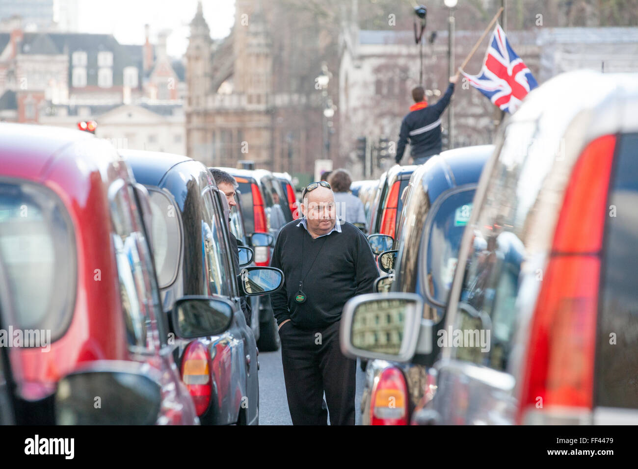 London, UK. 10th February 2016. Black cab taxi drivers hold a go-slow protest in Parliament Street in protest against Stock Photo