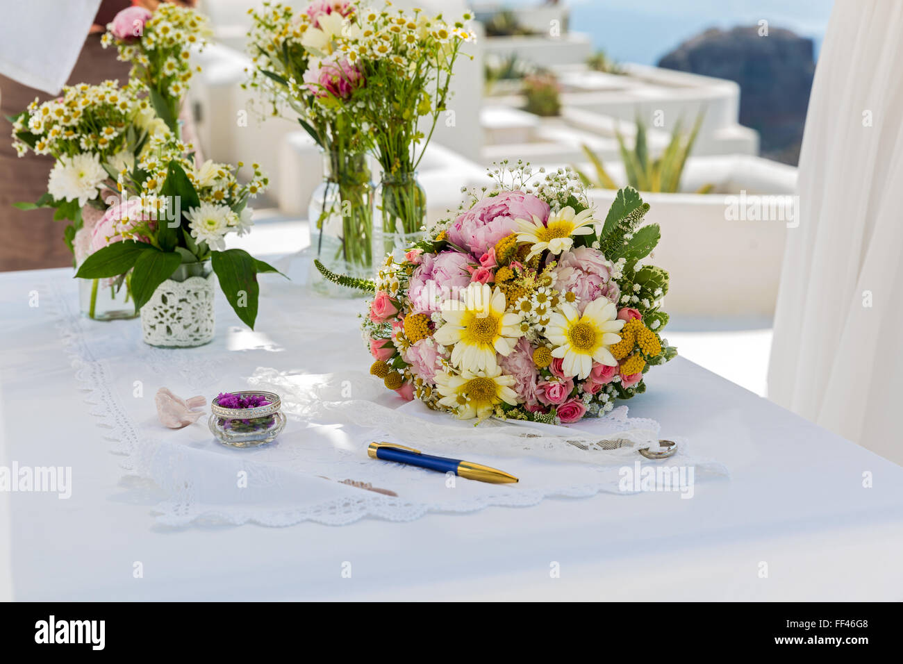 Wedding flowers on the table against the sea - Stock Image
