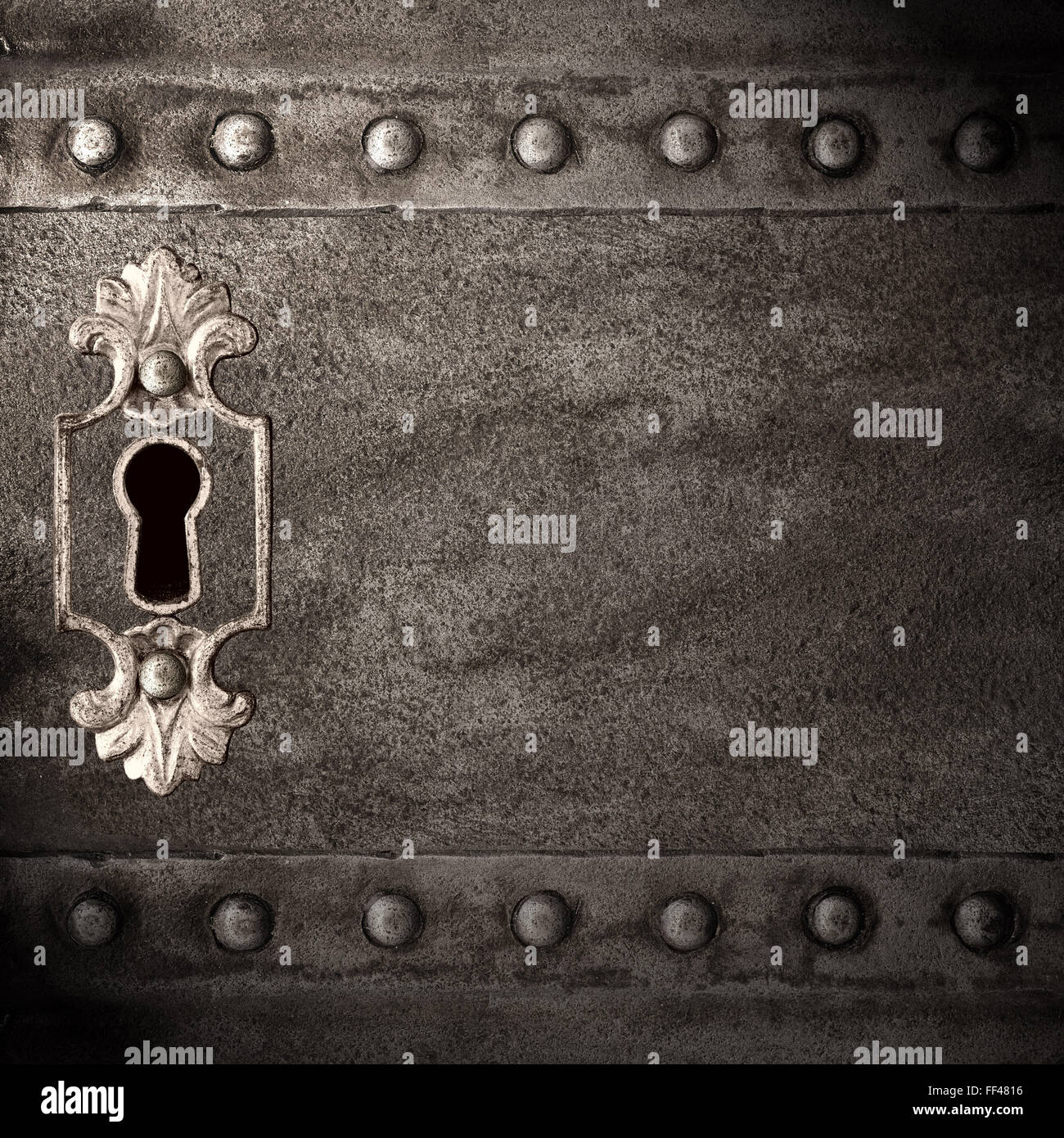 vintage keyhole in old iron doors, abstract background - Stock Image