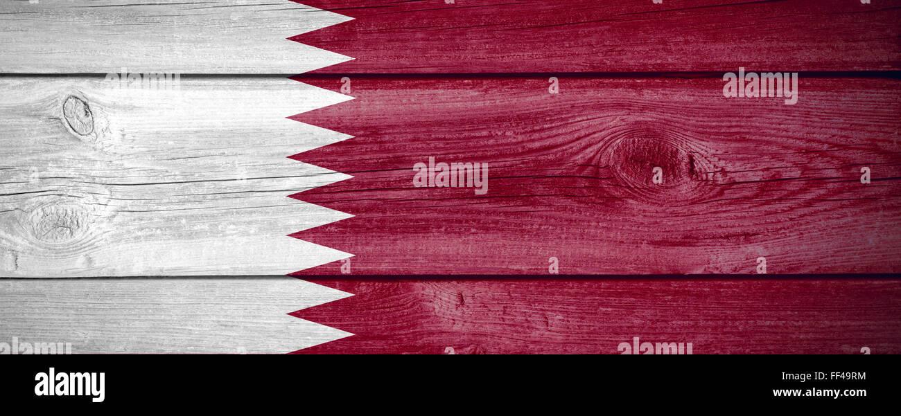 flag of Qatar or Qatari banner on wooden background Stock Photo