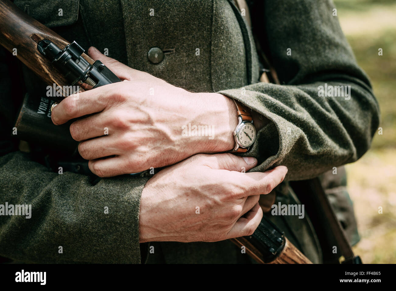 Close up of german military uniform of a German soldier. Unidentified re-enactor dressed as World War II German - Stock Image