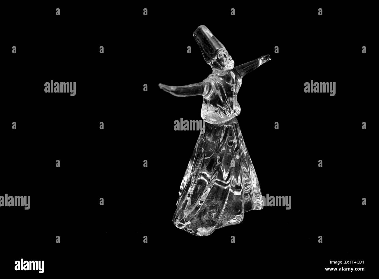 Whirling dervish isolated on black background - Stock Image