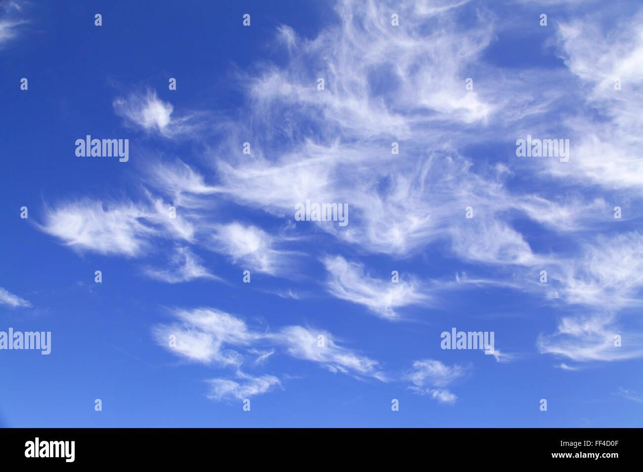 Wispy clouds in a blue sky UK - Stock Image