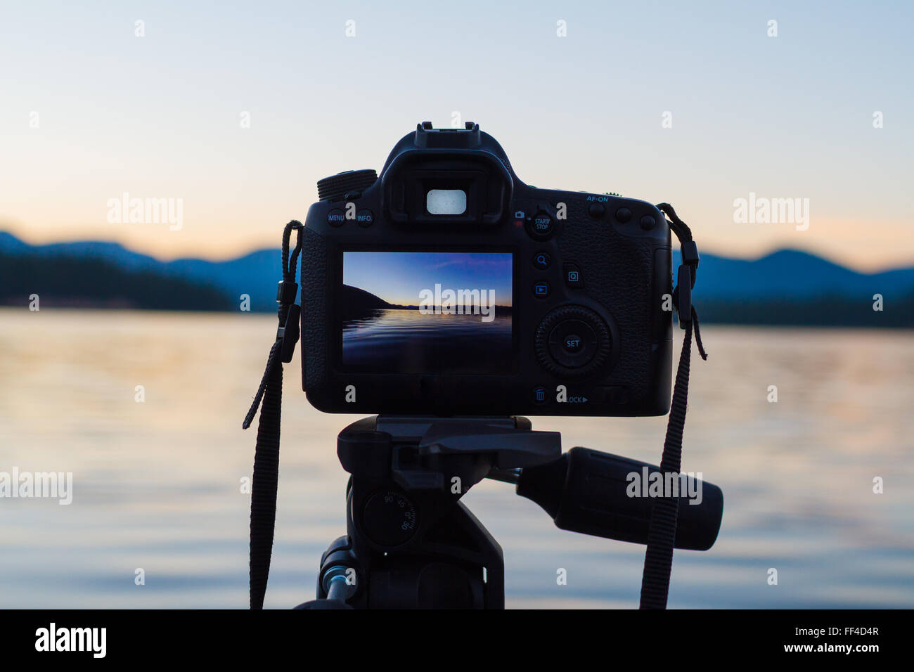 Sunset photos shot on a DSLR digital camera mounted to a tripod at a lake in Oregon. - Stock Image