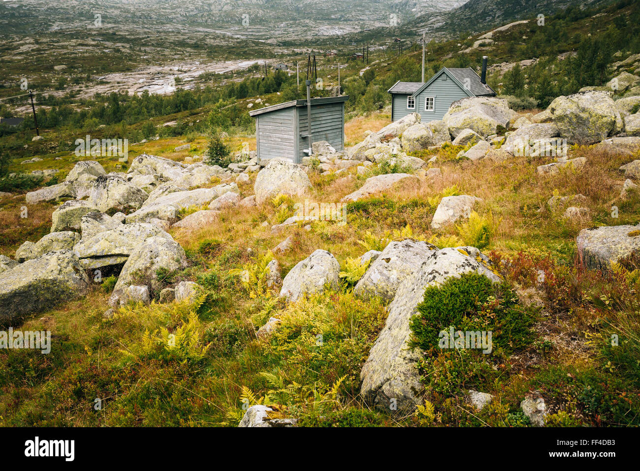 Tourist trail up the mountain tourism attraction - Trolltunga or Troll's Tongue rock in Hordaland county  in - Stock Image