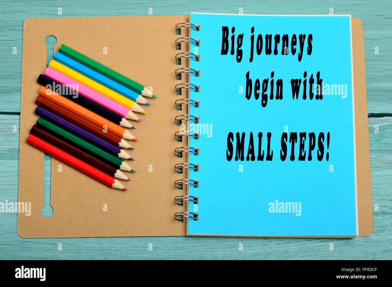 Big journeys begin with small steps written on notebook - Stock Image