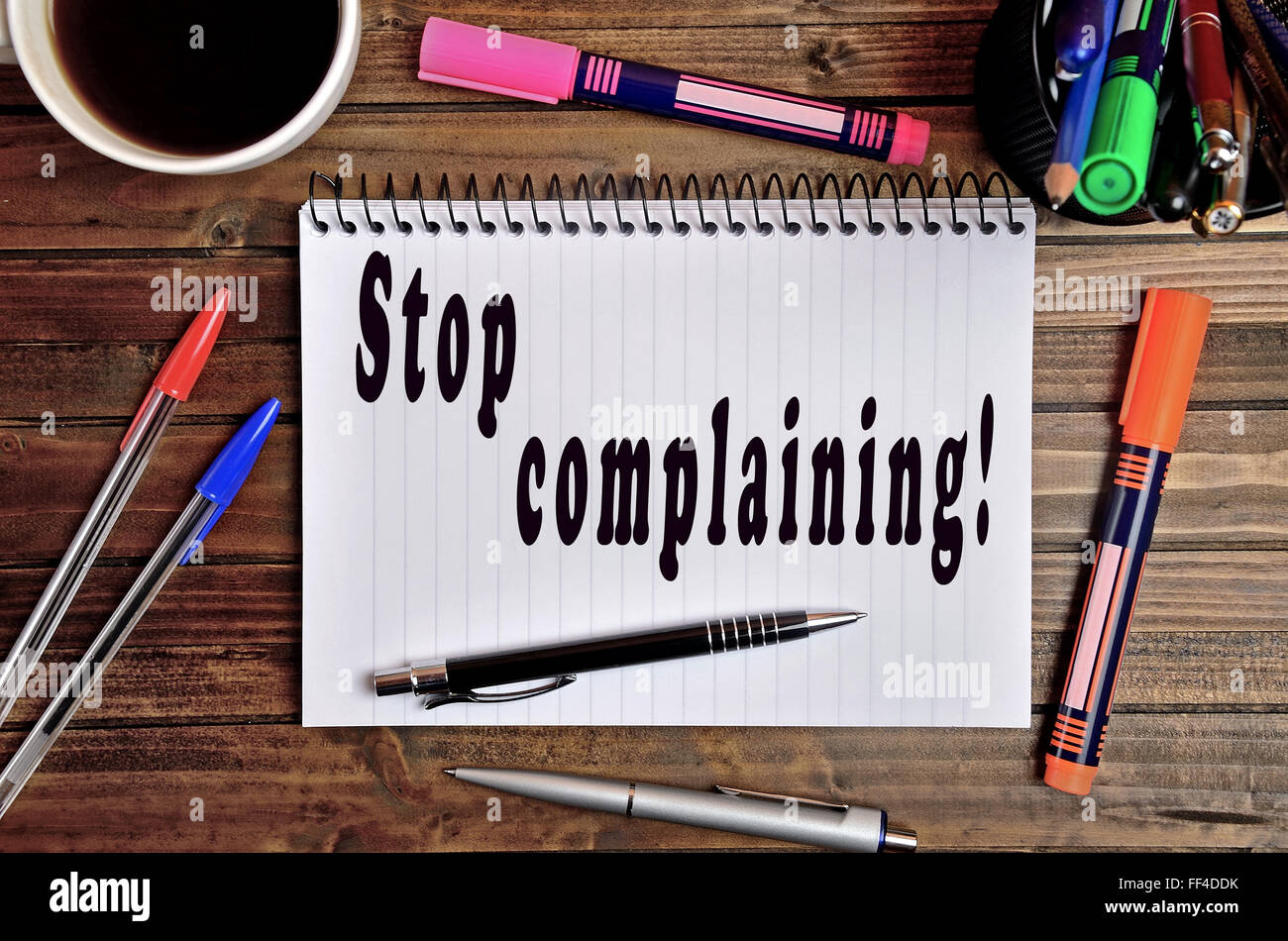 Stop complaining written on notebook - Stock Image