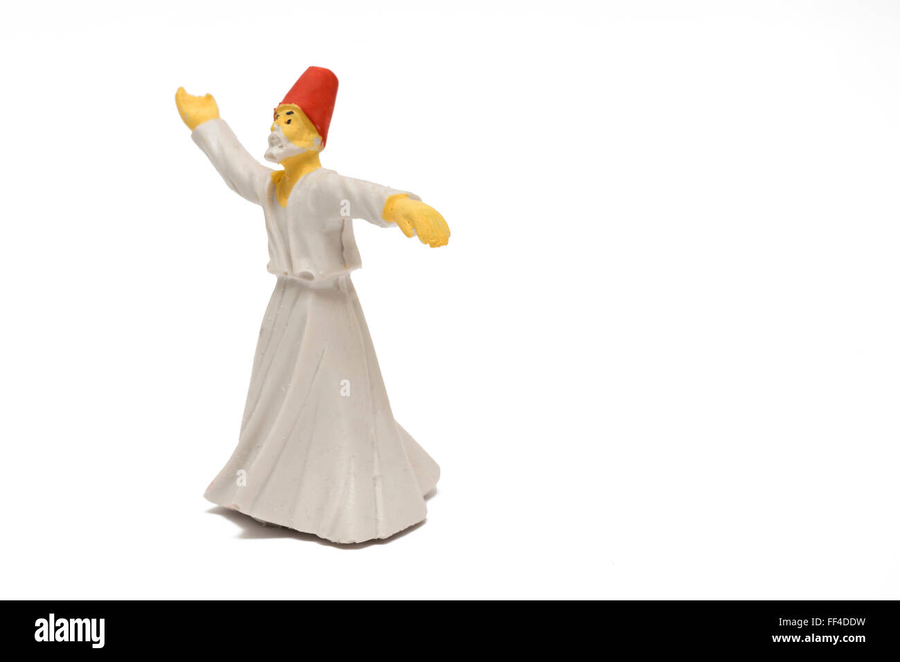 Whirling dervish isolated on white background - Stock Image