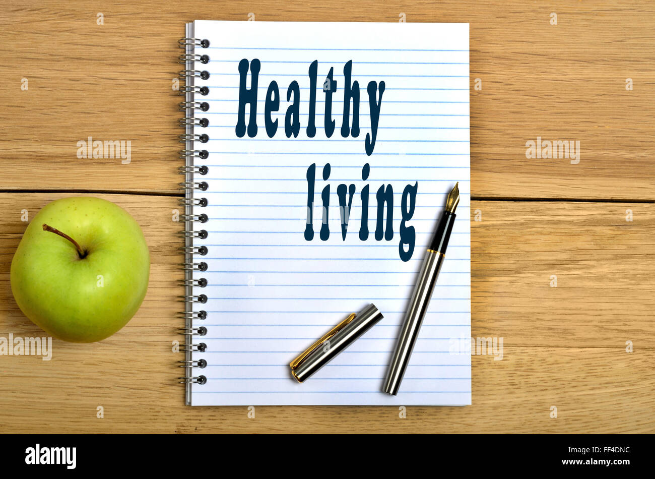 Healthy living words on notebook - Stock Image