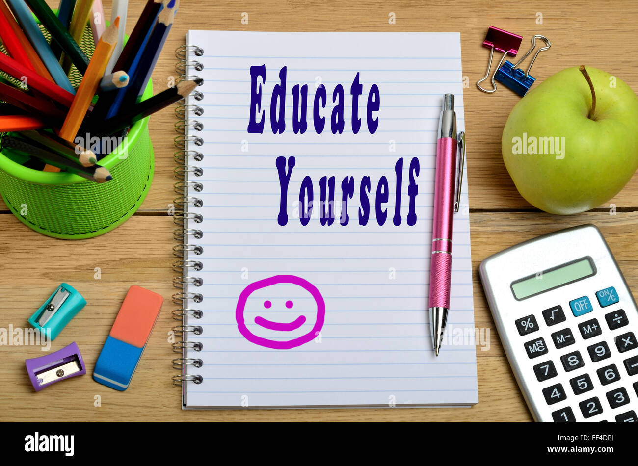 Educate yourself words on notebook - Stock Image