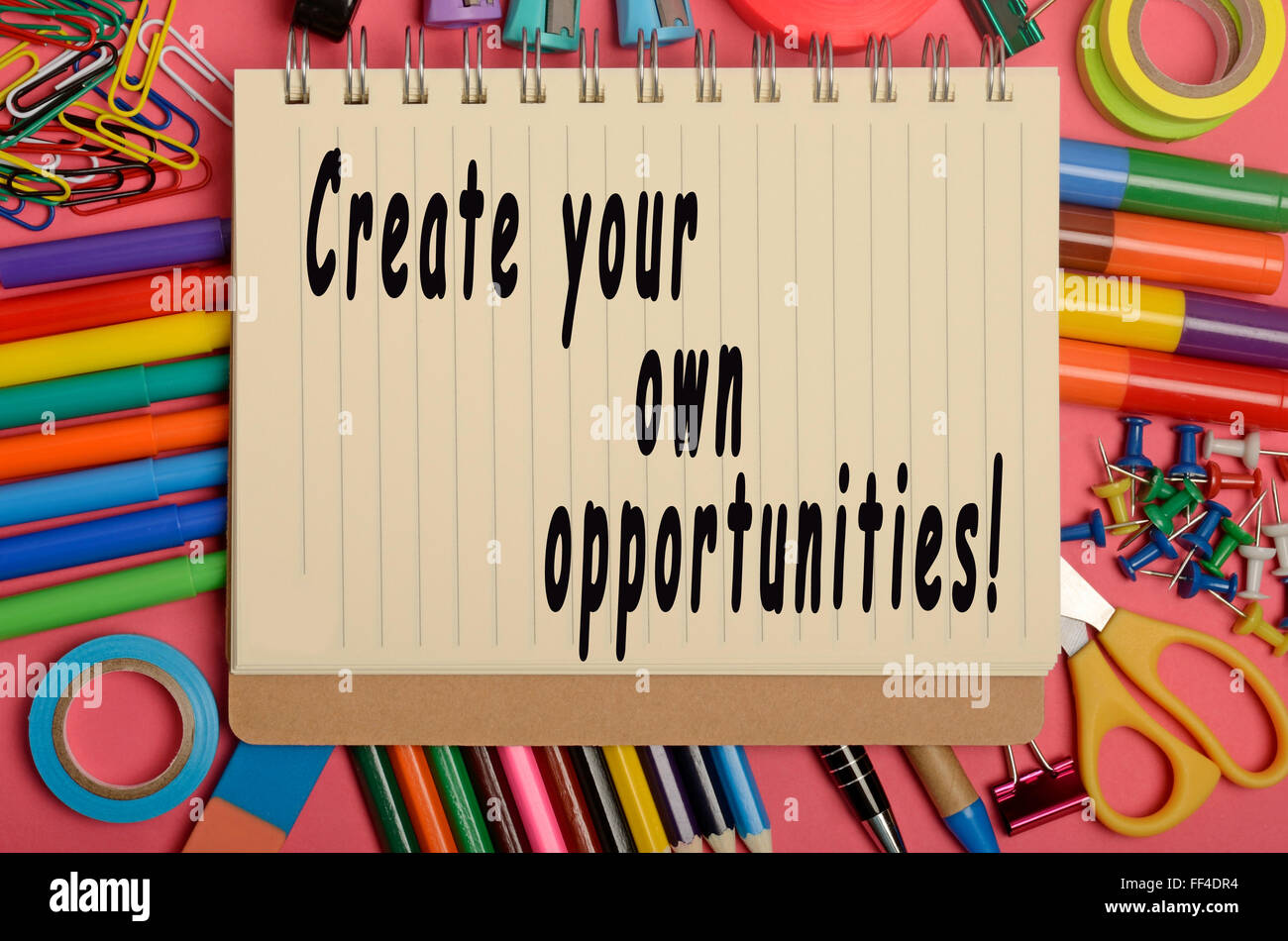 Create your own opportunities written on notebook - Stock Image