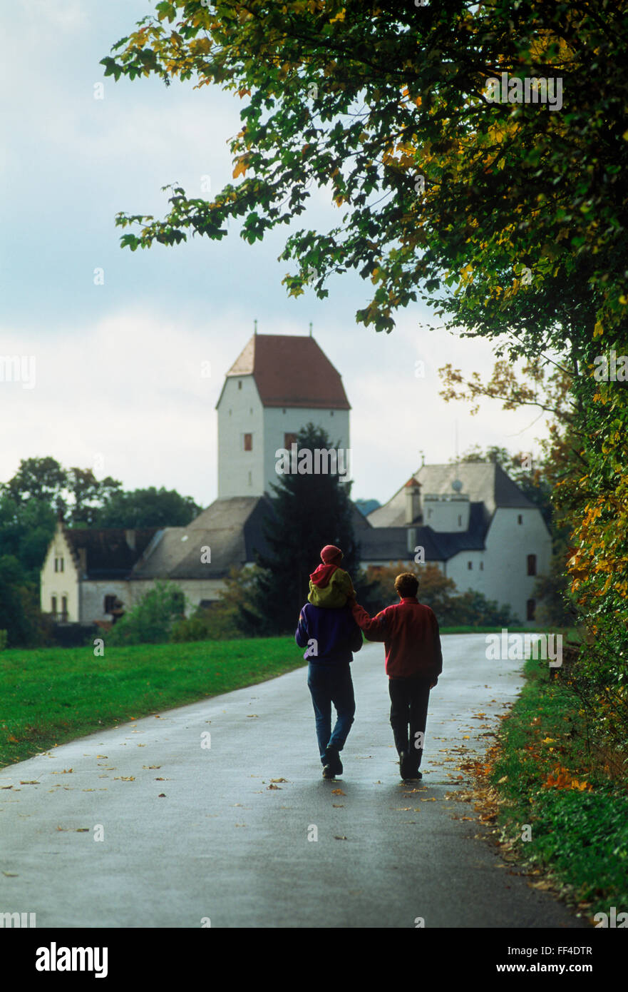 Family of three on country road in Graf in Bavaria,  Germany - Stock Image