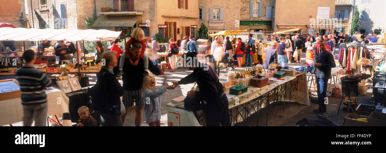Panoramic image of open air markets, shoppers and restaurants at Old Town of Sarlat in Dordogne France - Stock Image