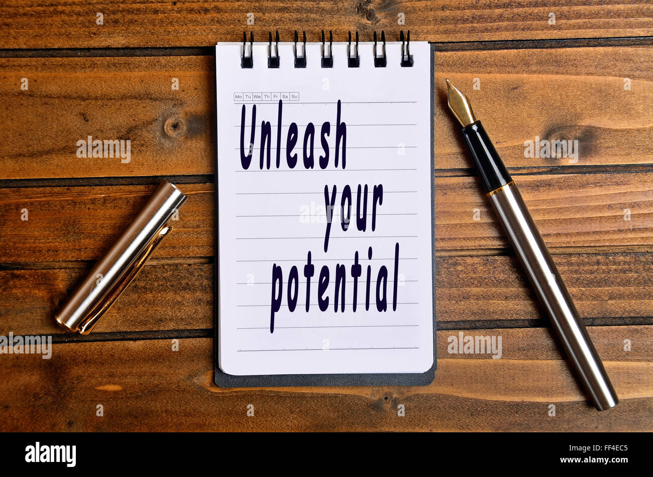 Unleash your potential text written on notebook - Stock Image