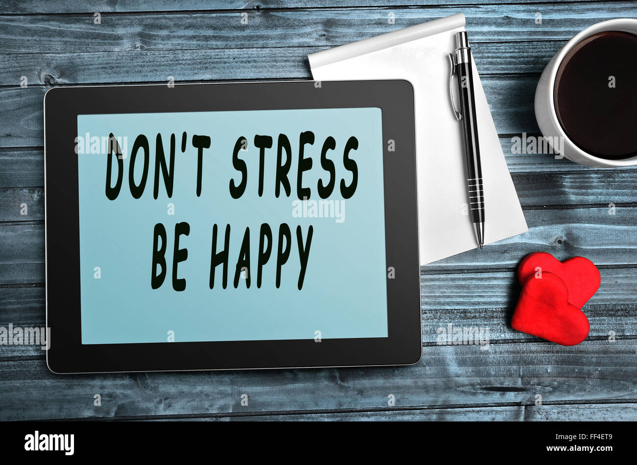 Don\'t stress,be happy quotes on digital tablet Stock Photo ...