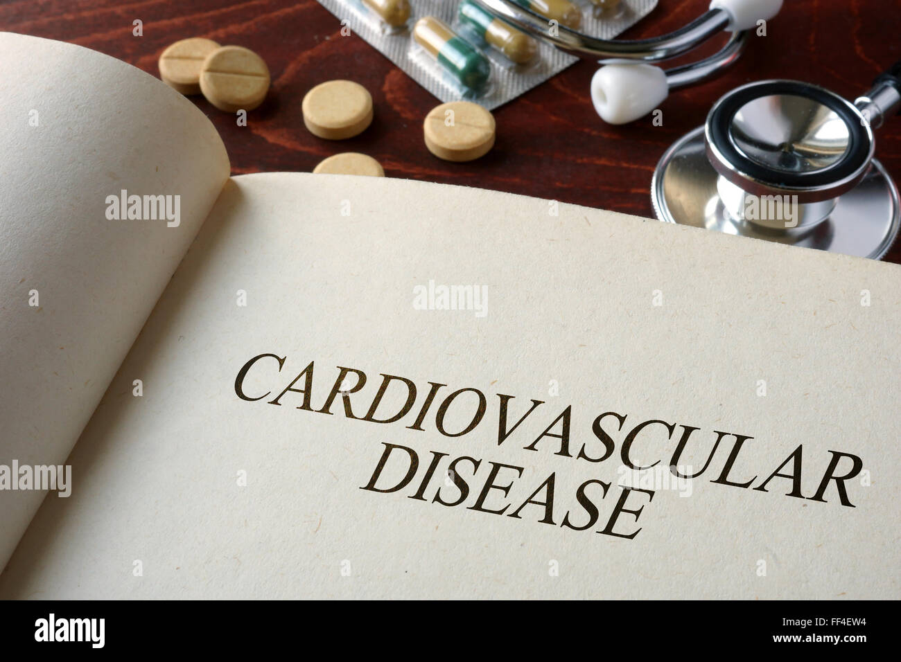 Book with diagnosis cardiovascular disease and pills. Medical concept. - Stock Image
