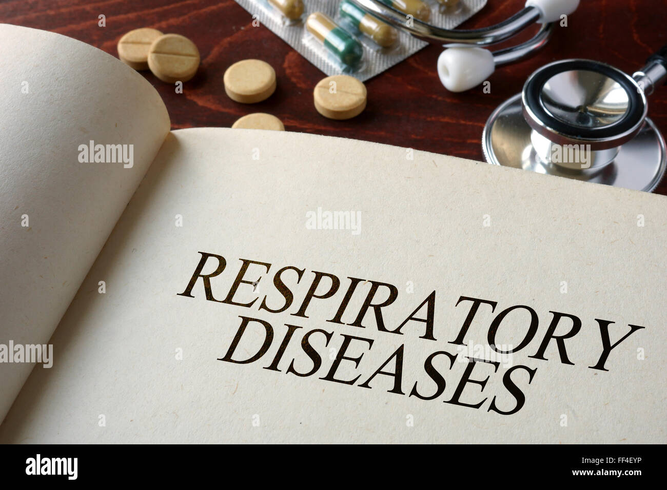 Book with diagnosis respiratory diseases and pills. Medical concept. - Stock Image