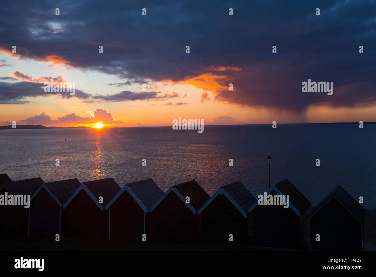 Isle of Wight, UK. 10th February, 2016. UK Weather, Sunset with approaching rainstorm, from Gurnard, Isle of Wight, - Stock Image