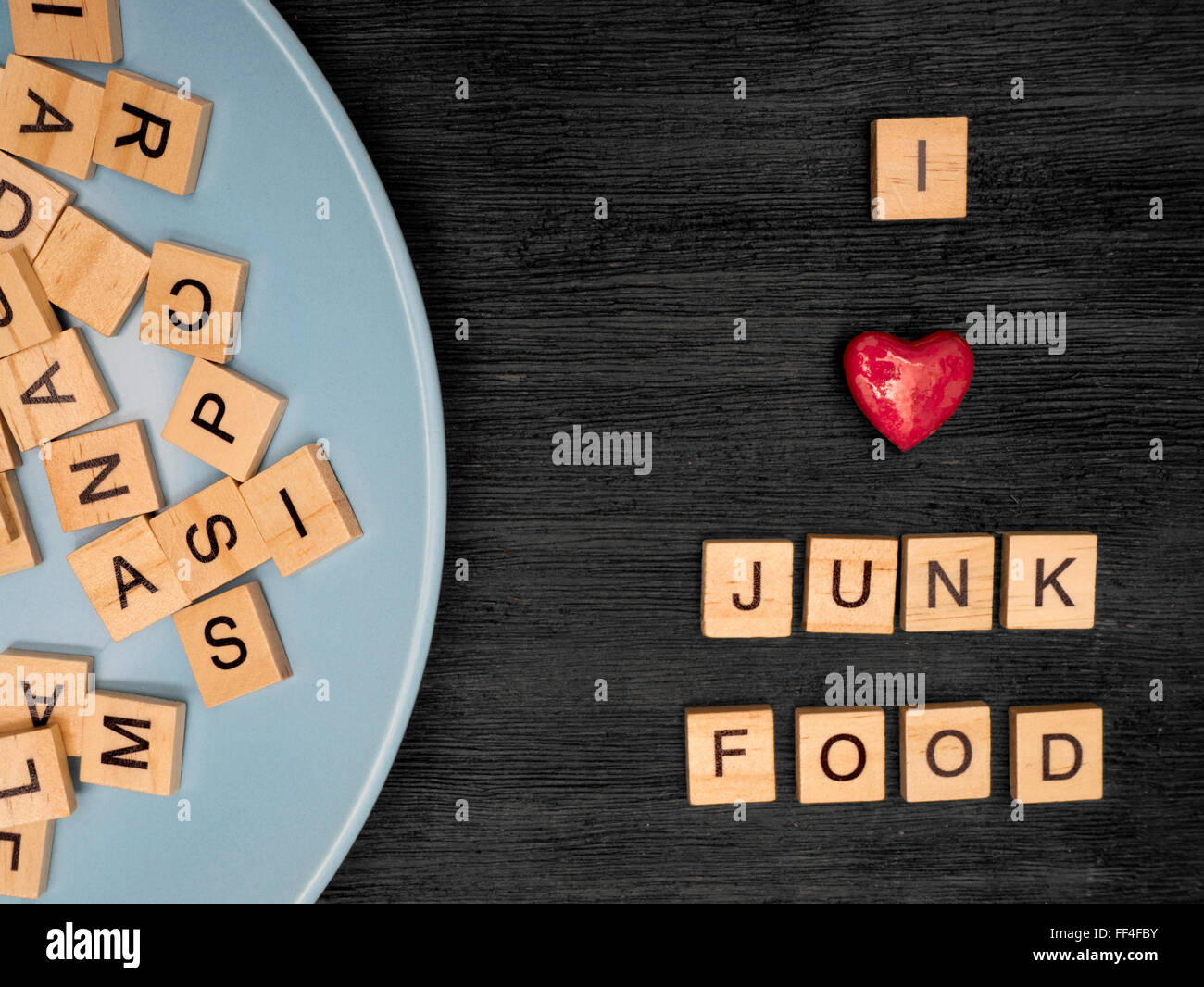 Wooden letters spelling Ι love junk food - Stock Image