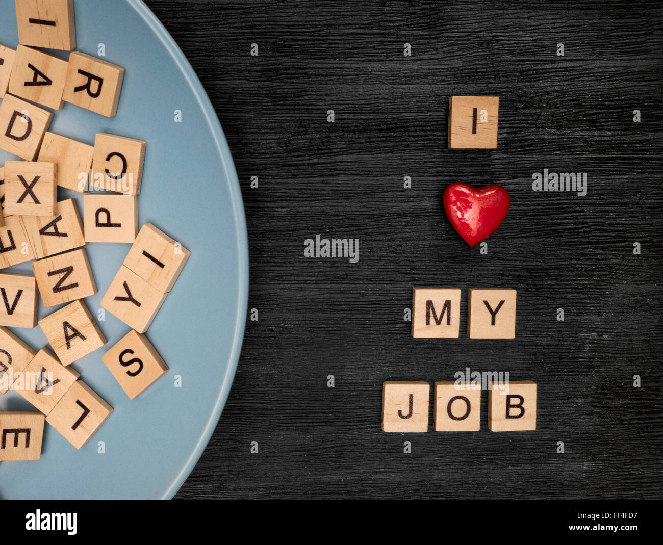 Wooden letters spelling I love my job - Stock Image