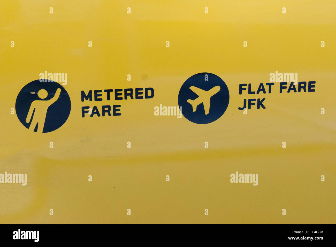 Side of a Yellow Taxi in NYC Metered Fare Flat Fare JFK - Stock Image