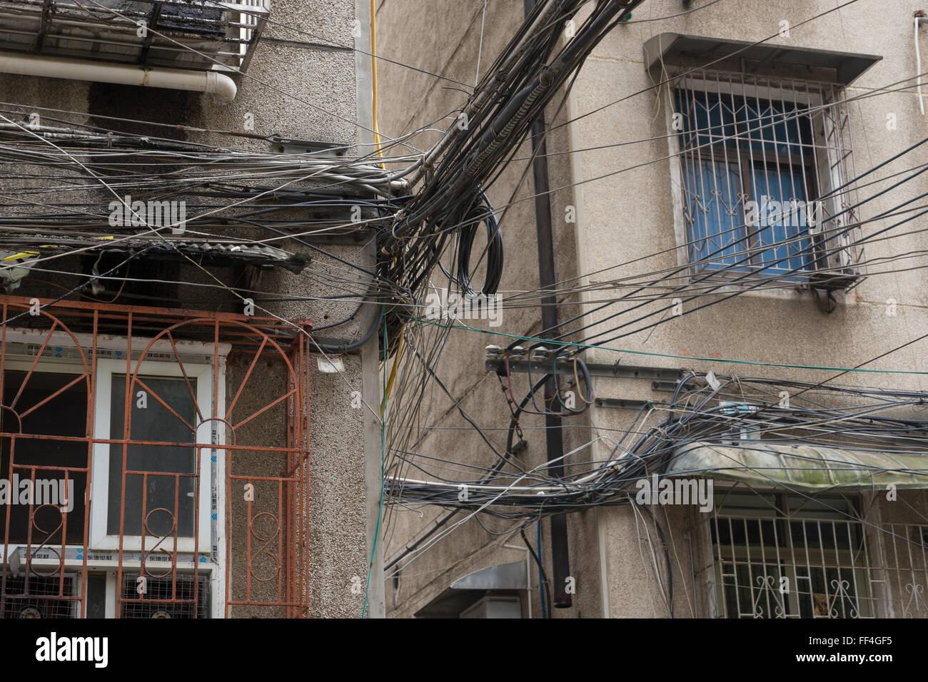 Messy electrical wiring in Xiangtan, Hunan, China - Stock Image