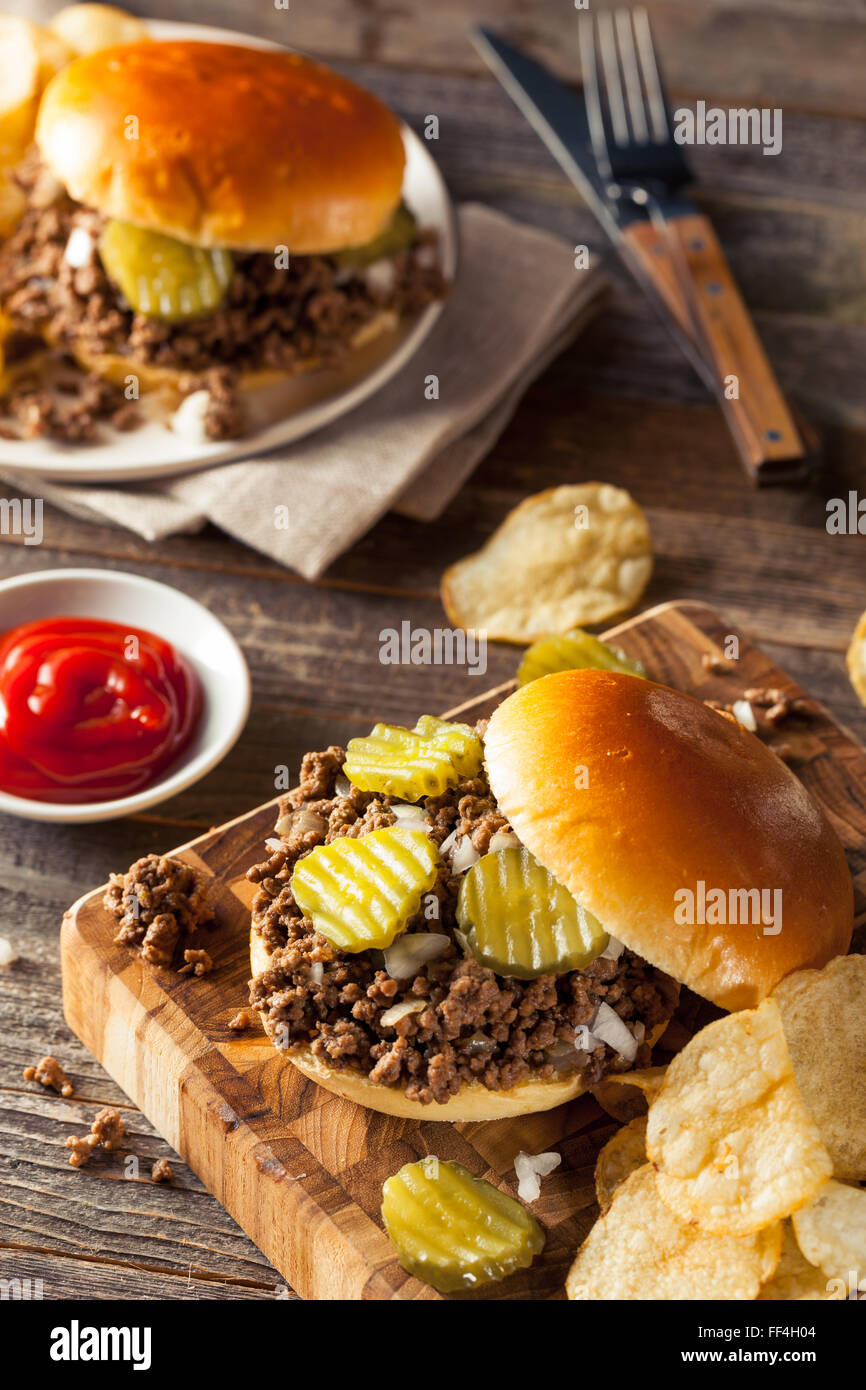 Homemade Loose Meat Tavern Sandwich with Onion and Pickle - Stock Image