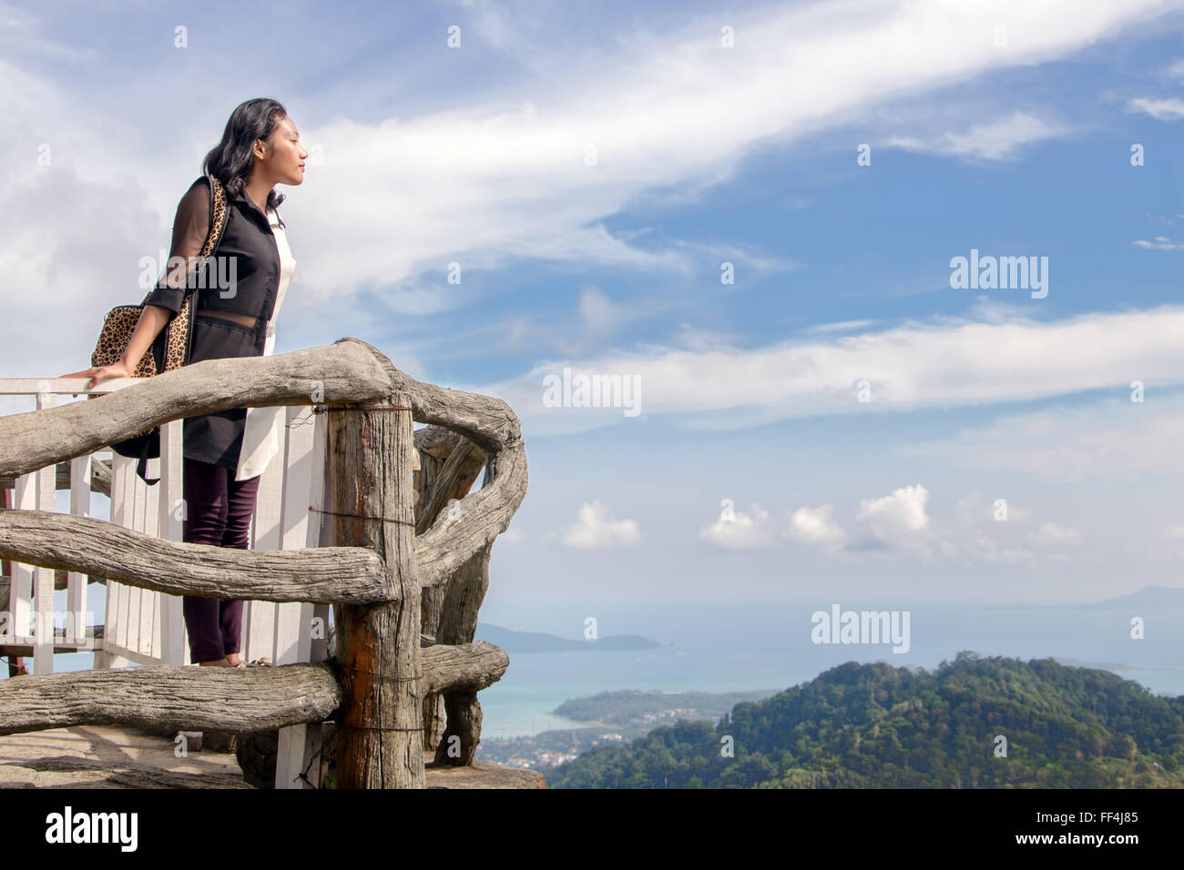woman watching view over the sea - Stock Image