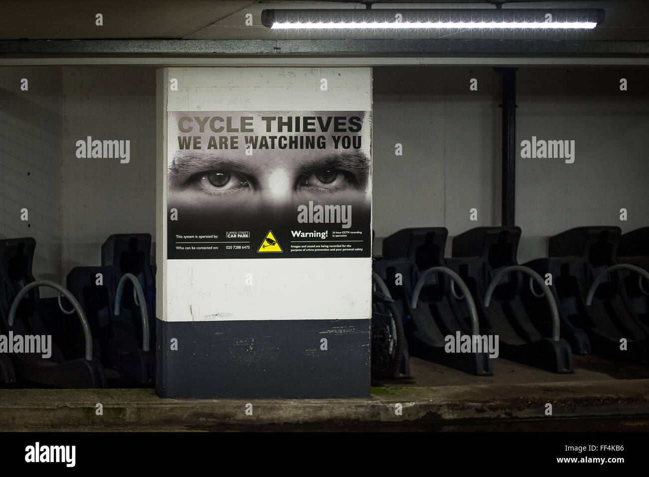 Warning to Cycle Thieves poster in underground car park, London, UK - Stock Image