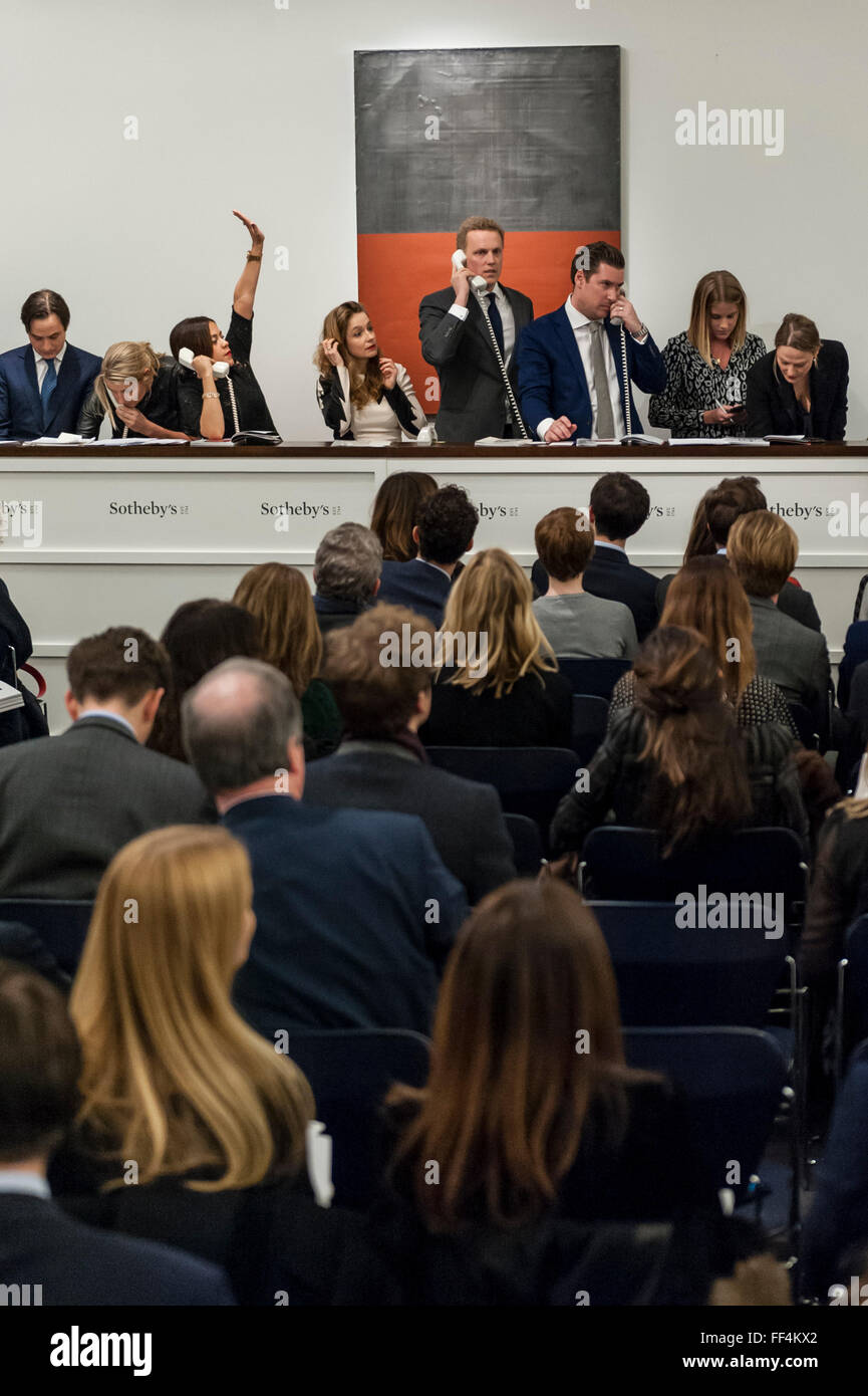 London, UK.  10 February 2016.  Sotheby's sales staff make bids on behalf of telephone clients standing in front - Stock Image